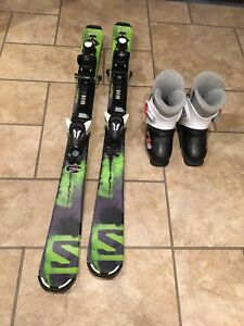Junior Solomon downhill skis and boots