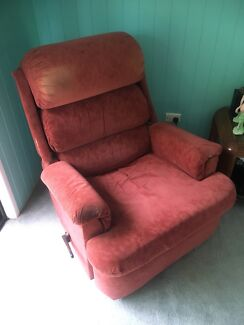 Red suede armchair