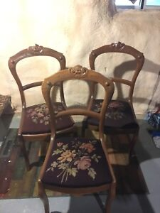 Three antique chairs with needle point seat