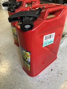 Metal Jerry Cans with Mounts. Brand new.