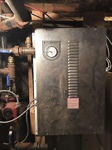 Système de chauffage à l'eau et deux compresseur pour frigidaire