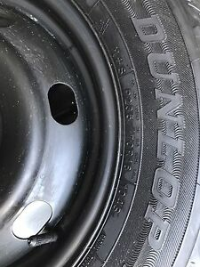 4 Dunlop snow tires mounted on Ford steel rims
