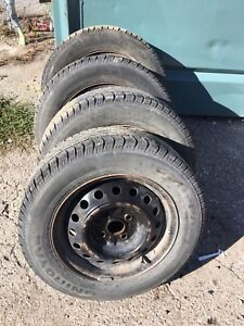 Four 185/65R14 tires in great condition !!! Like new !!