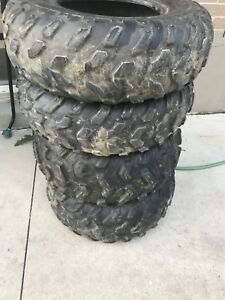 4 atv tires 2 AT25x8-12 and 2 AT25x10-12