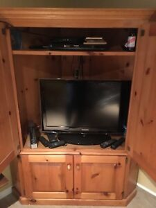 Corner pine entertainment cupboard.