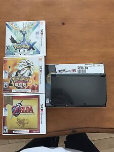 New 3ds XL + games + charger