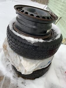 15 Volkswagen rims and three snow tires
