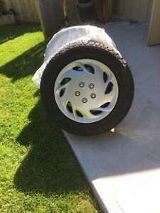 """Set of 16"""" Winter Tires on Rims w/Hubcaps $500 obo"""