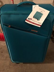 American tourister bayview 4 wheel trolley bag brand new