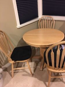 Wooden dining table with a set of 5 chairs & cushions