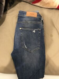 H&M Ripped skinny blue jeans like new. Size 30