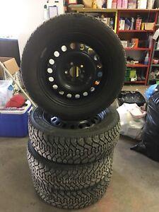 225/55/17  Goodyear Snow tires on rims