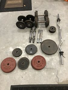 Steel weights plus commercial dumbbell handles and curl bar