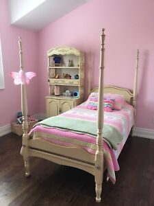 Twin bed with side cabinet