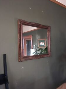 Mirror with antique wooden frame