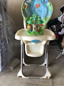 Highchair with baby carrier and clothes