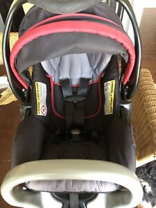 Infant rear-facing Baby Trend car seat with base