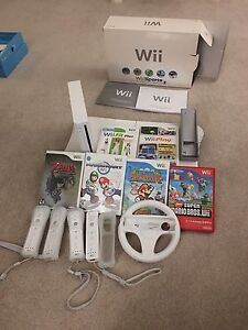 Wii, wii fit plus, 4 controllers, 6 games and steering wheel