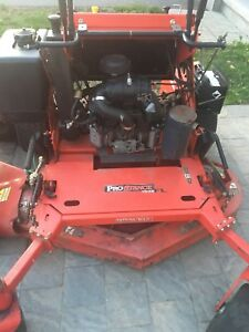"Solid Gravely Prostance ""stand on"" mower"