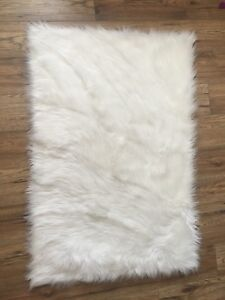 White faux fur area rug