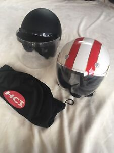 2 open face motorcycle helmets. Size small