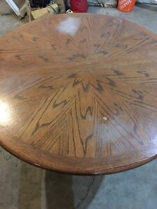 4' round solid oak table with leaf. Table only.Price drop
