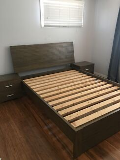 Timber queen bed with bedside drawers