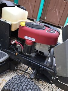 Craftsman riding lawnmower with lawnsweep