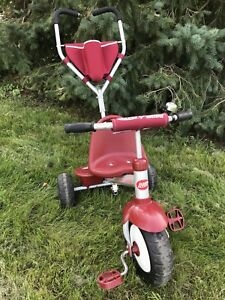 Childs Radio Flyer tricycle with stroller handle