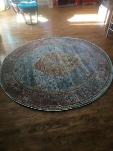 brand new- never used round rug