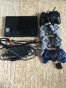 PlayStation 2 Slim + controllers, games, memory card Cambridge Kitchener Area image 1