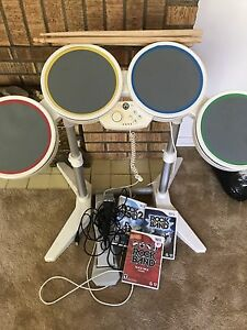 Wii rocks and with 3 games and microphone and drums