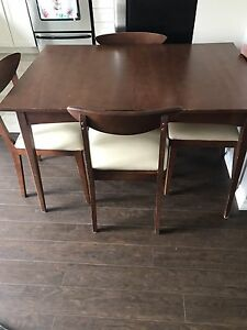 Wood table and chairs with hutch