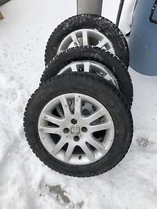 4 x 185 65 15 like new winter tires on Honda mags