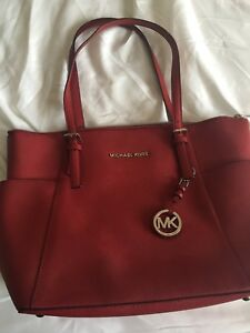Mk red medium size bag.