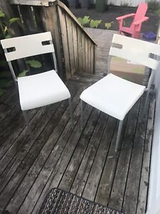 2 white and chrome plastic chairs