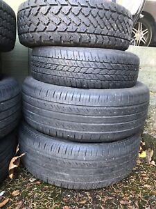 4 Toyota Corolla 98 tires. 4 Kia Sportage tires