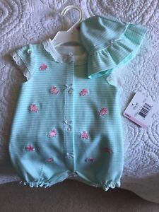 Baby girl brand new one piece with matching hat.