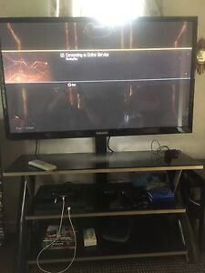 "50"" Samsung TV with Glass stand"
