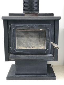 Osburn cast iron wood burner heater, flue and chimney