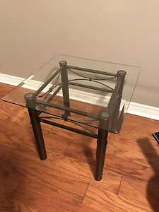 2 glass end tables.