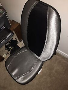 Body Massager works on a chair