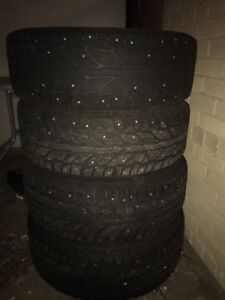4 studded winter tires steel rims 235/70R16