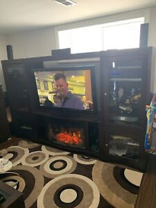 Entertainment wall unit with fireplace