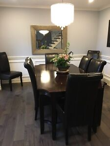 Table and 8 brown parsons chairs