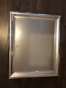 Chrome frames mirror with mounting hooks in back