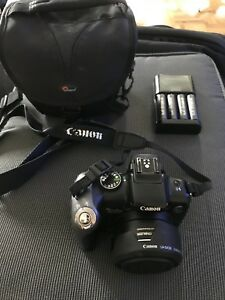 Canon PowerShot SX10IS 10.0MP w/Case 4xAA Batteries