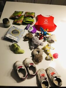 Used baby toys, bib, shoes and some unused new food pouches