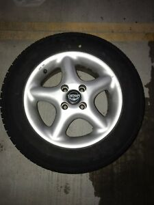 14 inch Mangel Rims with Raptor Riken all seasons