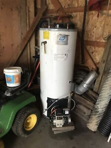 Oil powered hot water tank